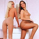 Lesbians in pantyhose stretch and play with their nylons